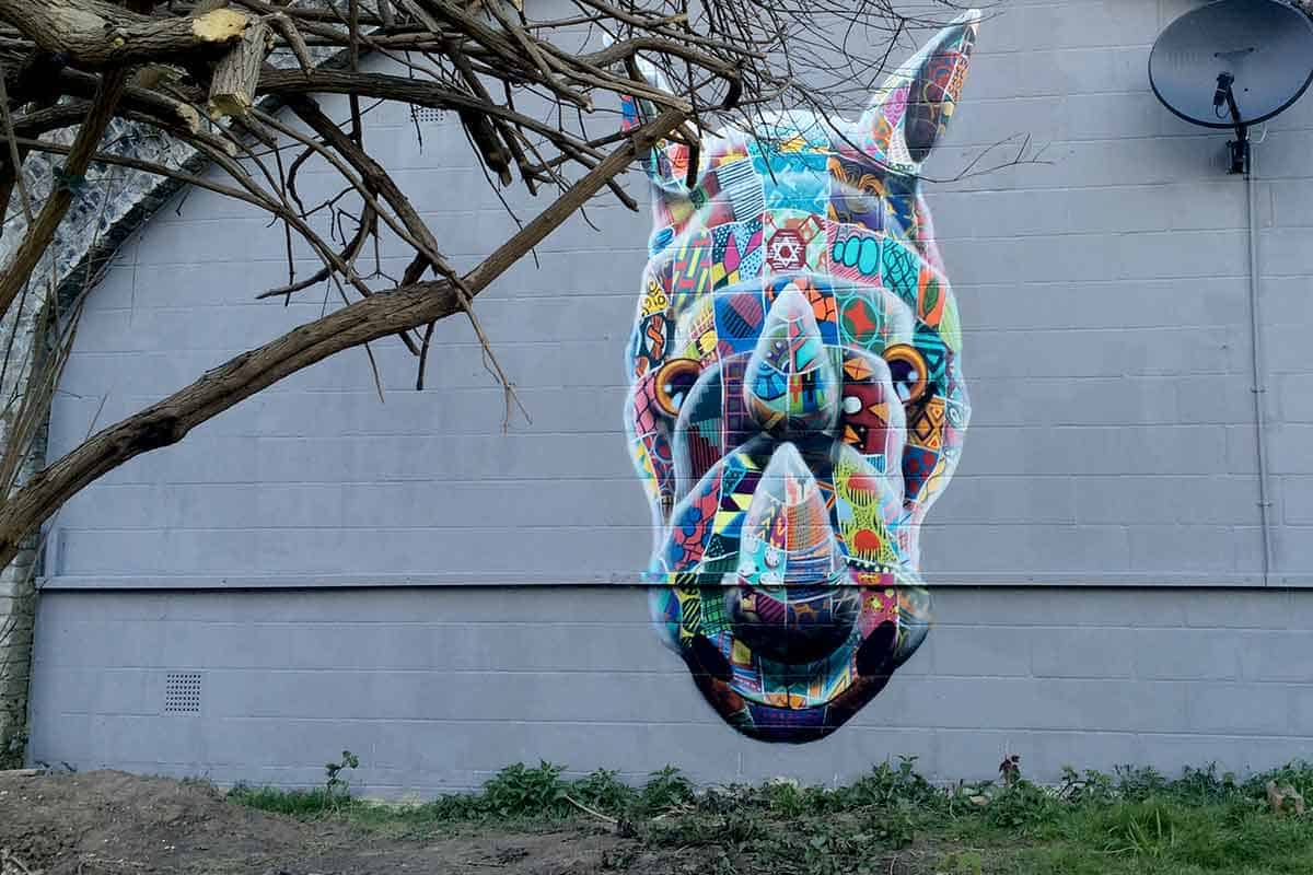 Louis Rhino Mural on one of the arches at the Tower Hamlet Cemetery in London – Image from the Human Nature Website