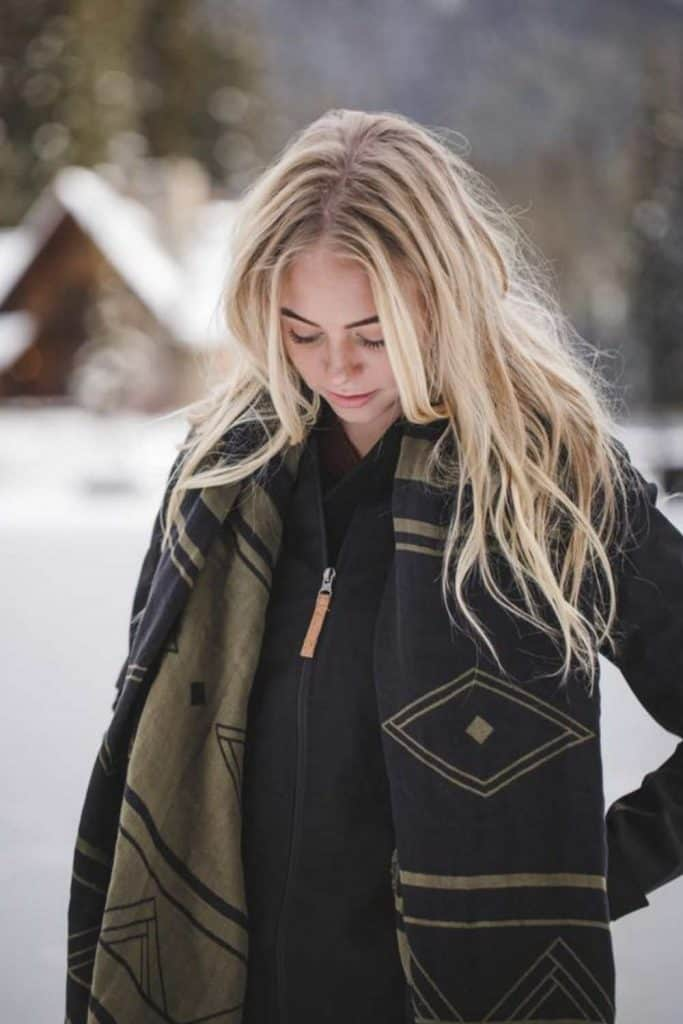 For winter fashionistas, a warm and cozy scarf (almost) completes the picture. A fair trade scarf, however, really ticks all the boxes. Image by Tentree #fairtradescarves #sustainablescarves #ecofriendlyscarves #sustainablejungle