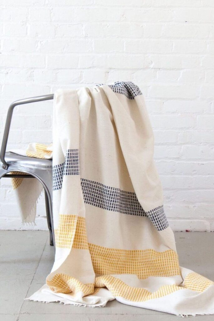 We're not a fan of blanket stealers OR practices that steal a healthy planet from future generations… which is why we're wrapping up in sustainable and fair trade blankets. Image by Ocelot Market #sustainableblankets #fairtradeblankets #sustainablejungle