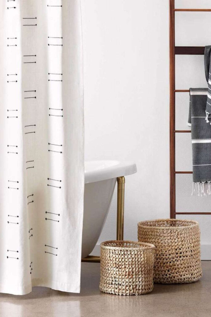 To make our hygiene habits a little healthier, we went on a hunt for the best eco friendly shower curtains. Here's what sustainable showering looks like by the brands doing it best. Image by Wild Canary Shop #ecofriendlyshowercurtains #sustainableshowercurtains #sustainablejungle