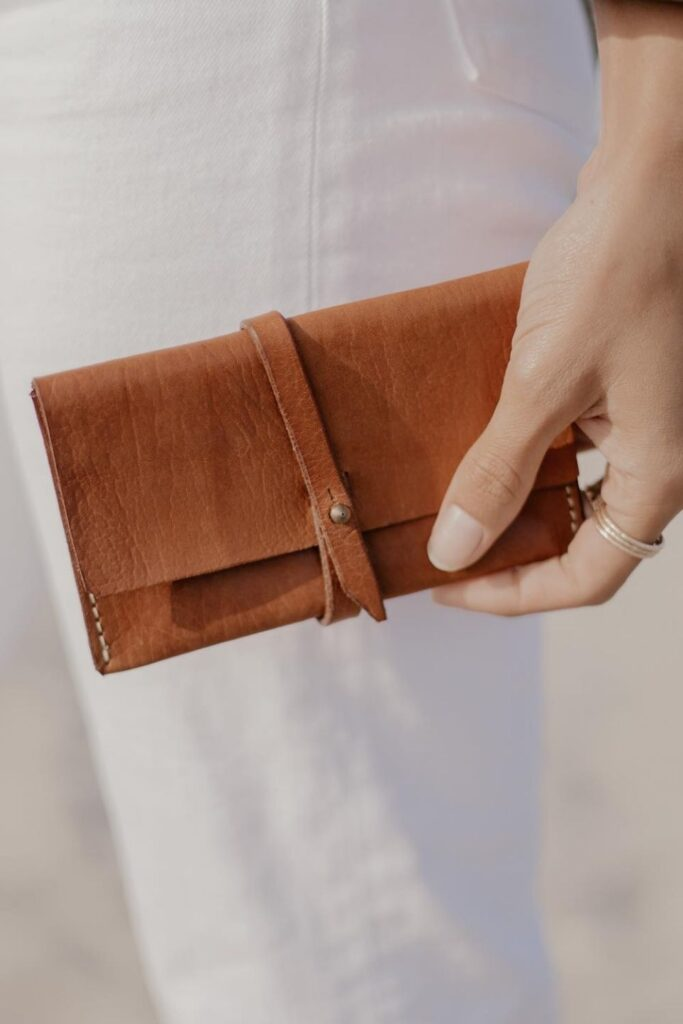 Keep your cash green and pay it forward through the purchase of a sustainable wallet. Not one made with toxin-tanned leather and plastic-based synthetics. Image by The Zero Waste Store #sustainablewallet #ecofriendlywallet #sustainablejungle