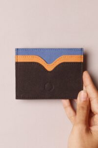 Keep your cash green and pay it forward through the purchase of a sustainable wallet. Not one made with toxin-tanned leather and plastic-based synthetics. Image by Funky Kalakar #sustainablewallet #ecofriendlywallet #sustainablejungle