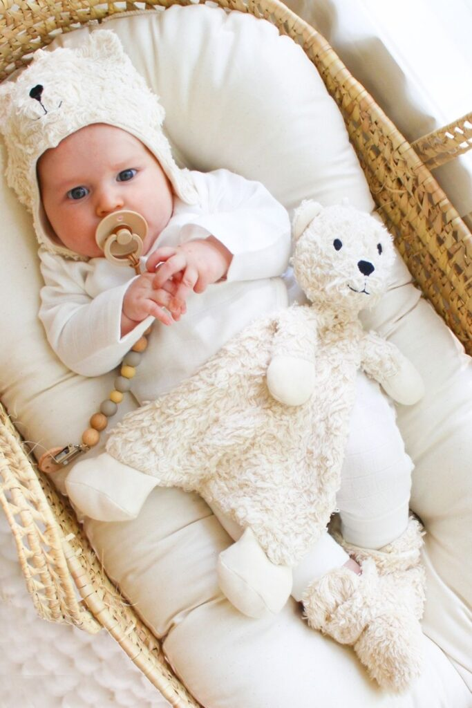 We've explored what it means to raise a zero waste baby, but what about zero fuss babies...you know, a baby playing happily with their new non toxic and organic baby toys. Image by Under The Nile #organicbabytoys #organicbabytoysmadeintheusa #bestorganicbabytoys #nontoxicbabytoys #bestnontoxicbabytoys