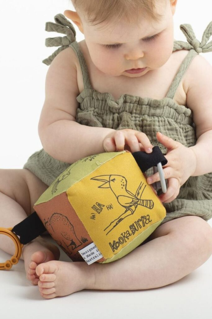 We've explored what it means to raise a zero waste baby, but what about zero fuss babies...you know, a baby playing happily with their new non toxic and organic baby toys. Image by finch and folk #organicbabytoys #organicbabytoysmadeintheusa #bestorganicbabytoys #nontoxicbabytoys #bestnontoxicbabytoys