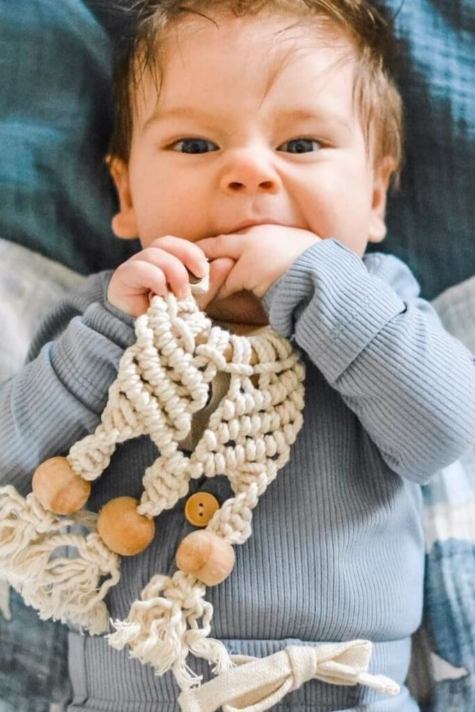 We've explored what it means to raise a zero waste baby, but what about zero fuss babies...you know, a baby playing happily with their new non toxic and organic baby toys. Image by Finn & Emma #organicbabytoys #organicbabytoysmadeintheusa #bestorganicbabytoys #nontoxicbabytoys #bestnontoxicbabytoys