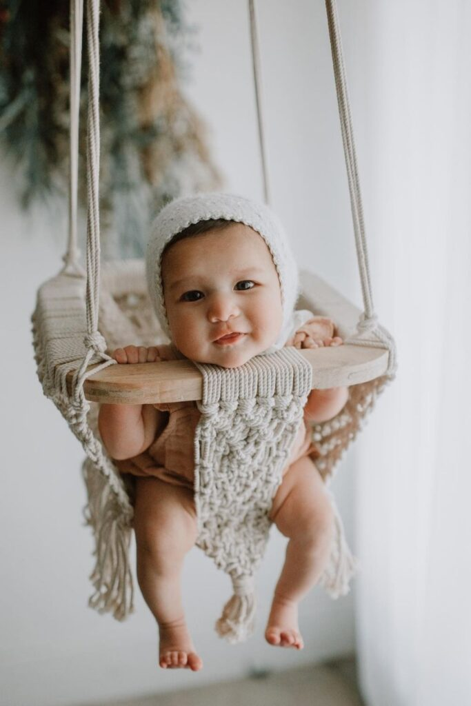 We've explored what it means to raise a zero waste baby, but what about zero fuss babies...you know, a baby playing happily with their new non toxic and organic baby toys. Image by Finn + Emma #organicbabytoys #organicbabytoysmadeintheusa #bestorganicbabytoys #nontoxicbabytoys #bestnontoxicbabytoys