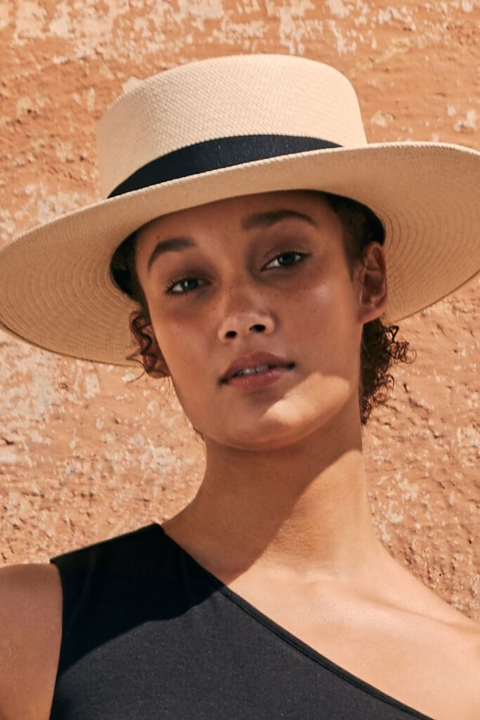Style, sustainability, AND skin protection?! How's that for a hat trick? Here's our list of the best sustainable and fair trade hats that do a whole lot of good... Image by Cuyana #sustainablehats #fairtradehats #sustainablejungle